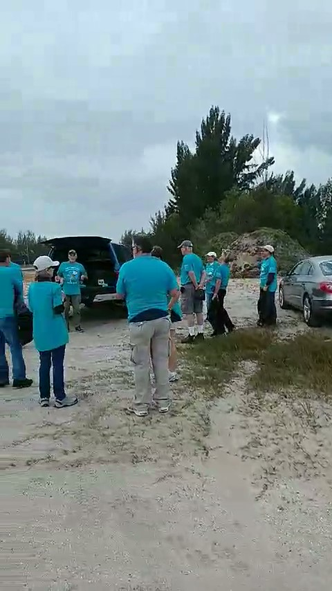 People gathering with other members to help clean up trash.