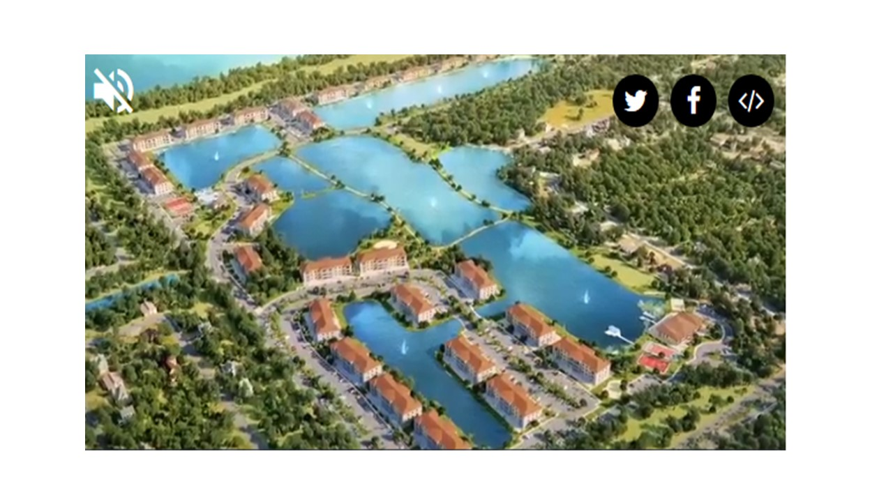 Ariel view of lakes surrounded by apartments and walking paths.