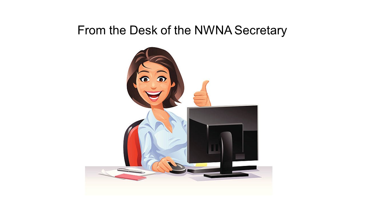 Picture of secretary giving the thumbs up at her desk.